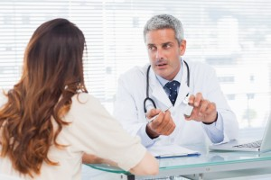 Doctor Speaking With Patient At Desk